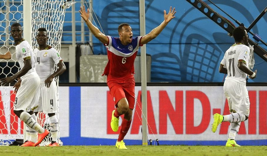United States' John Brooks, centre, celebrates after scoring his side's second goal during the group G World Cup soccer match between Ghana and the United States at the Arena das Dunas in Natal, Brazil, Monday, June 16, 2014. The United States won the match 2-1.