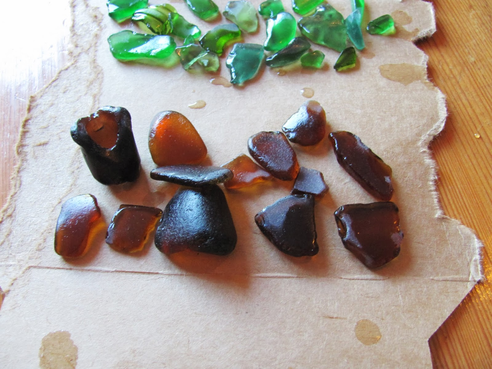 Brown sea glass is on display on a cardboard box in Dublin, Ireland