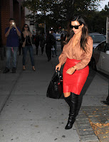 Kim Kardashian looking hot in leather skirt