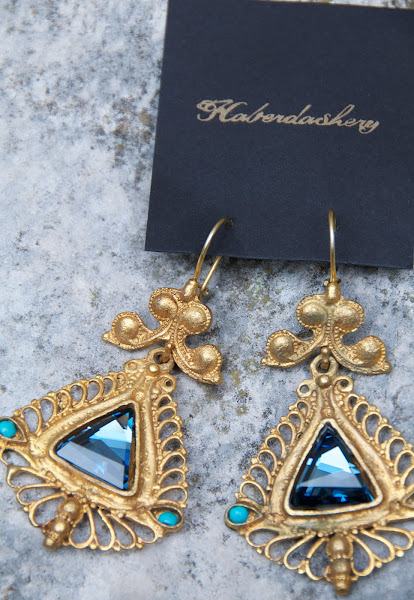 Blue earring with filigree detail.