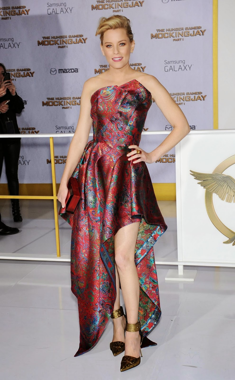 Elizabeth Banks in a strapless paisley gown at The Hunger Games: Mockingjay Part 1 LA premiere