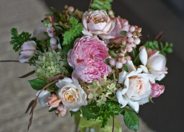 bouquet of english roses hydrangea snowberry and honeysuckle