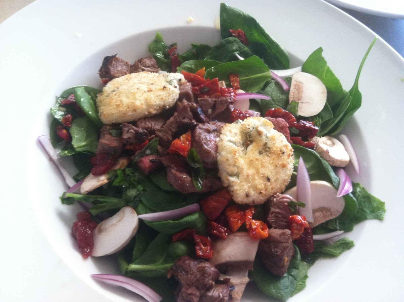 ... and Delicious: Sun-Dried Tomato and Warm Goat Cheese Steak Salad