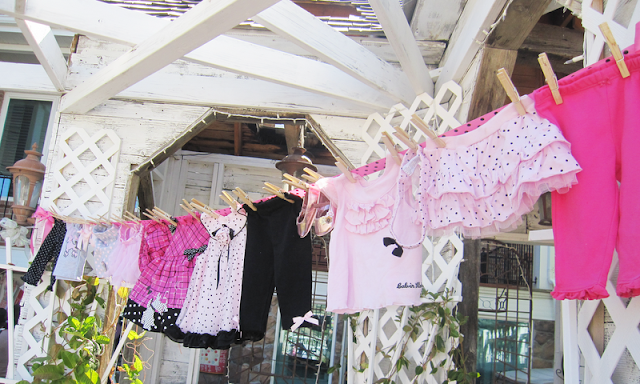 Parties and patterns baby shower decoration idea for Baby clothesline decoration