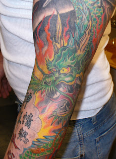 Asian Themed Dragon Arm Sleeves Tattoo Design