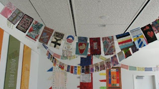 many prayer flags hanging inside a museum