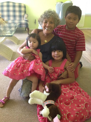 Toastmaster of the Year Elaine Gavero with her 3 grandchildren