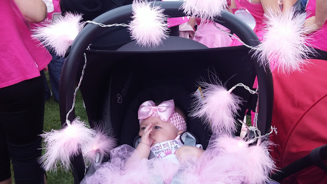 baby at cwmbran race for life 2015 in pink tutu with pink fluffy fairy lights decorating pushchair