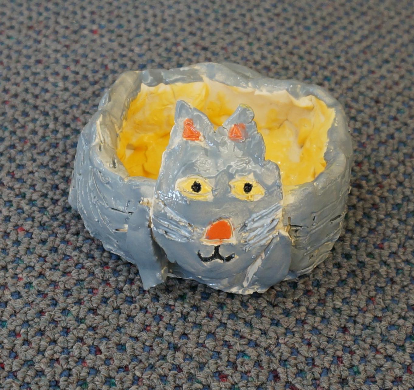 that artist woman animal pinch pots