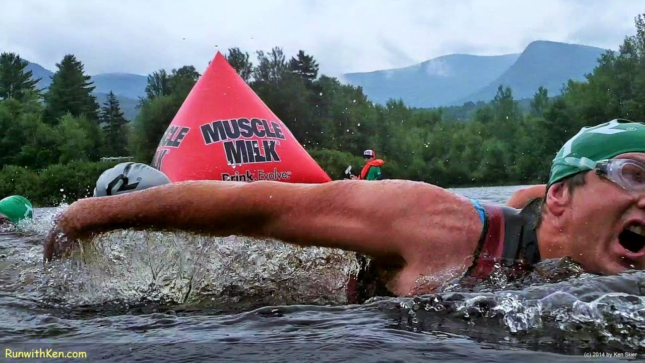 Up-close action photo of triathlete, open water swimming at the Mad River Endurafest Triathlon in Waterville Valley, NH. Photography from Inside the Pack by Ken Skier, the Swimming Photographer. (RunwithKen.com) The Mad River Endurafest is produced by Sun Multisport Events (SunMultisportEvents.com)