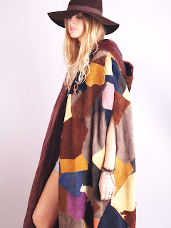 Vintage 1970's multi-colored patchwork heavy maxi cape with side slit arm openings and hood.