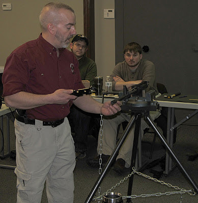 Dave Laubert demonstrates taking apart AR upper