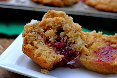 Peanut Butter and Jelly Muffins - Turn a classic sandwich into a soft, rich, and tender muffin. Peanut butter base with your favorite jelly in the middle!