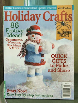 My snowman is featured on the cover of Better Homes & Gardens!