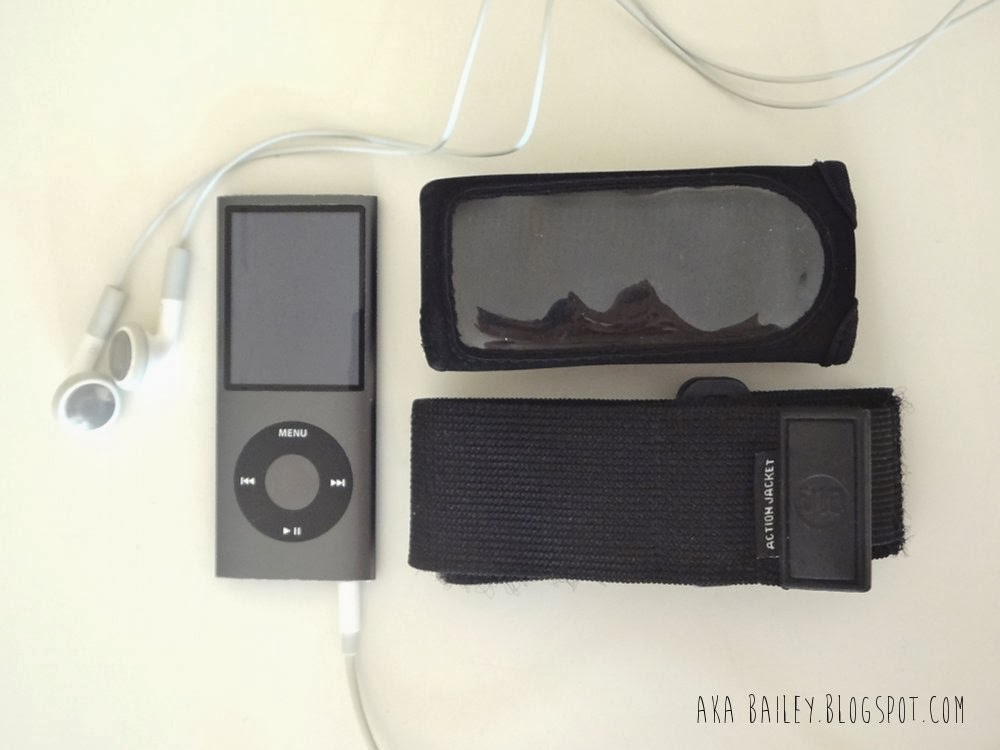 Charcoal iPod Nano 8GB 2008 model, with black DLO Fitness Case and arm strap
