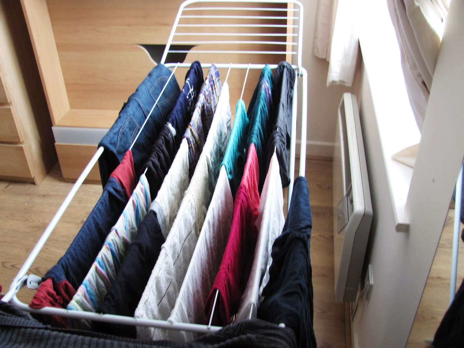 Clothes hand on a collapsible wire drying rack