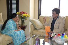 Asha Bhosle in an animated conversation with