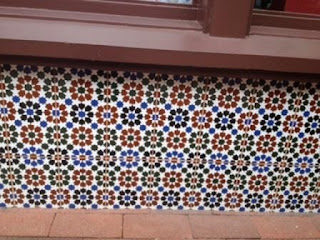 "This installation of  6"" x 6"" tiles resembles Moroccan zillij tiles."