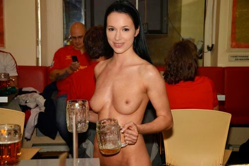 super sexy indian topless waitress serving beer at the bar
