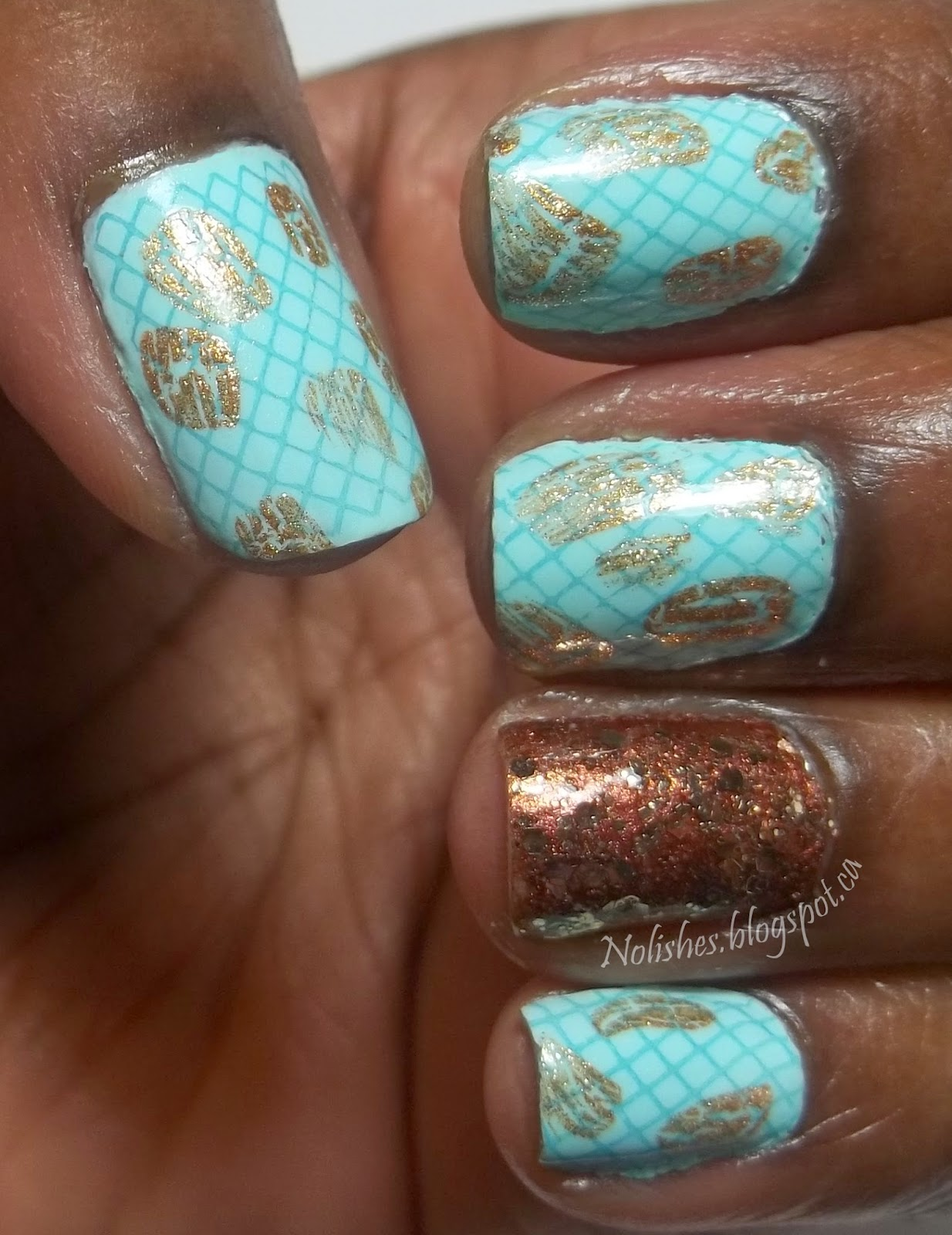 Nail stamping manicure featuring light blue polish on all nails except for ring finger, stamped with a medium blue thin lattice pattern, and then embellished with wisps of bronze crackle polish. The ring finger is painted with bronze polish, and covered in bronze glitter.