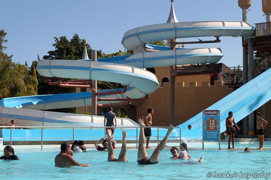 Swimmers enjoy the hot sunny weather at Splash Planet, Hastings. photograph