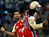 virat kohli and chris gayle celebrate after winning a ipl 2013 match