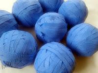 Sustainable fashion – making yarn using recycled blue wrap (balls of blue wrap yarn)