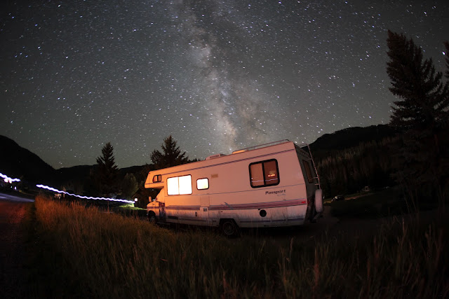 The view of the Milky Way over an RV in the campground at Sylvan Lake State Park.