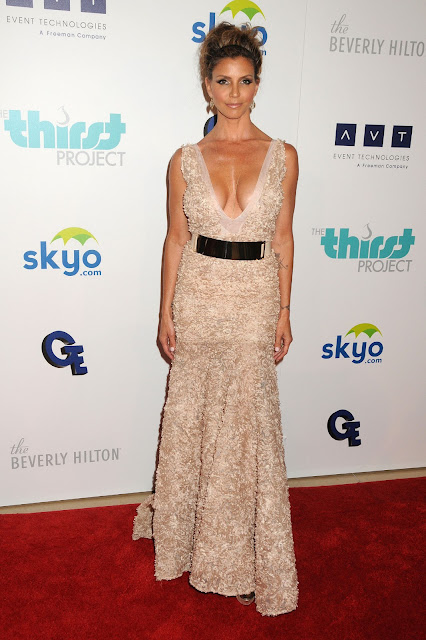 Charisma Carpenter wearing a revealing dress on the red carpet