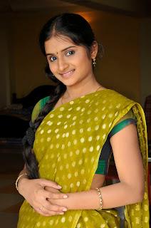 Priyanka Tiwari Homely girl in half Green Transparent Saree Spicy Pictures