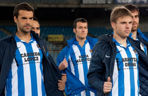 Real Sociedad players have a message for their fans: 'We carry you on our shirts'