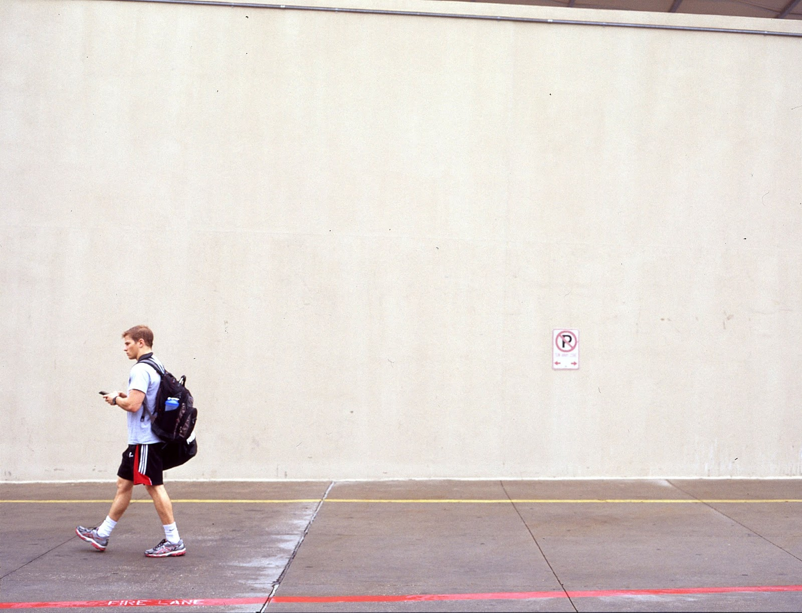 Campus pedestrian walks near rec sports