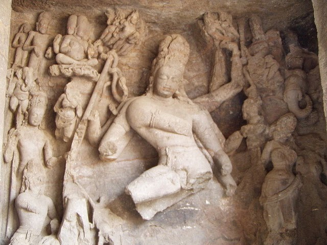 A broken statue of Shiva as Nataraja at elephanta caves