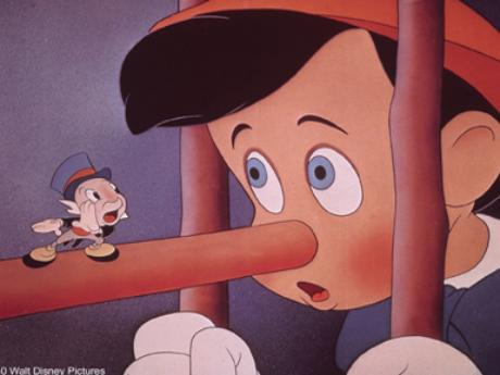 Jiminy Cricket stands on the boy's nose in Pinocchio 1940 disneyjuniorblog.blogspot.com