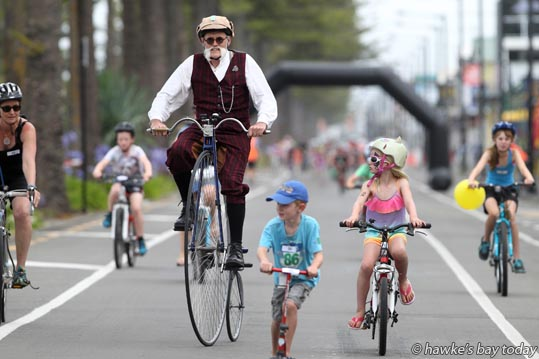 Colin Barnes, Haumoana, on his penny farthing, riding in the Big Save Family Ride, part of the Summer Cycling Carnical, riding the 1.1km criterium circuit on Marine Parade, Napier, before the serious event, the Bay Espresso Criterium. photograph