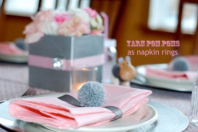 very creative napkin ring made from a yarn pom pom