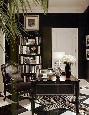 home office black and white checkered floor tile black walls zebra hide rug