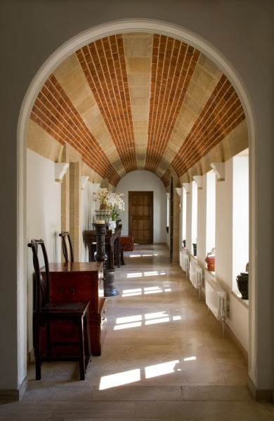 stunning corridor showing impressive exposed brick ceiling