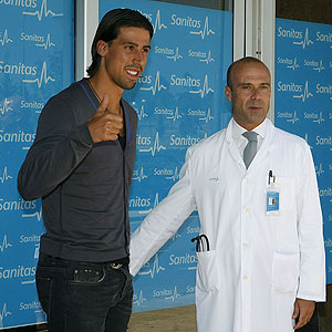 Khedira with a Real Madrid doctor