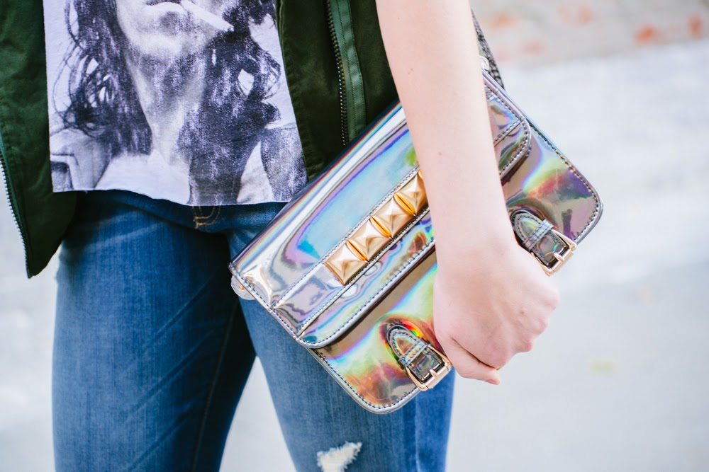hologram purse | In good faith, Tess