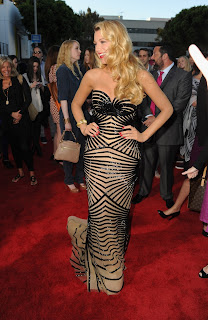 Blake Lively on the red carpet in a floor length gown