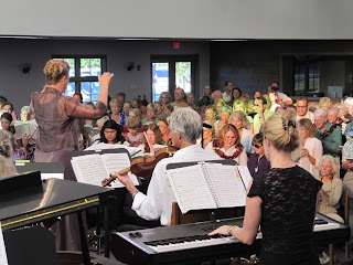 Angie Carr on keyboard,Don Lax 1st violin and Celia Canty conductor