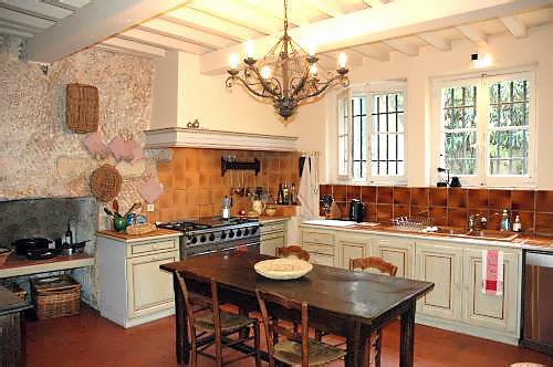 Painted Cabinets And Ceiling Beams Are Indications Of A Country French  Kitchen/