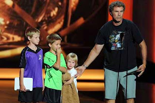 Will Ferrell and his three sons on stage at the Emmys