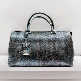 Jil Sander Jil Bag in dark blue metallic knitted leather.