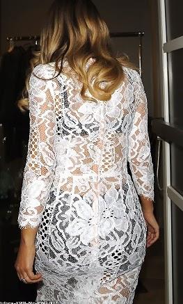 Exclusive Photos ; Kim Kardashian Shows  off her  underwear in sheer see thru white  lace dress
