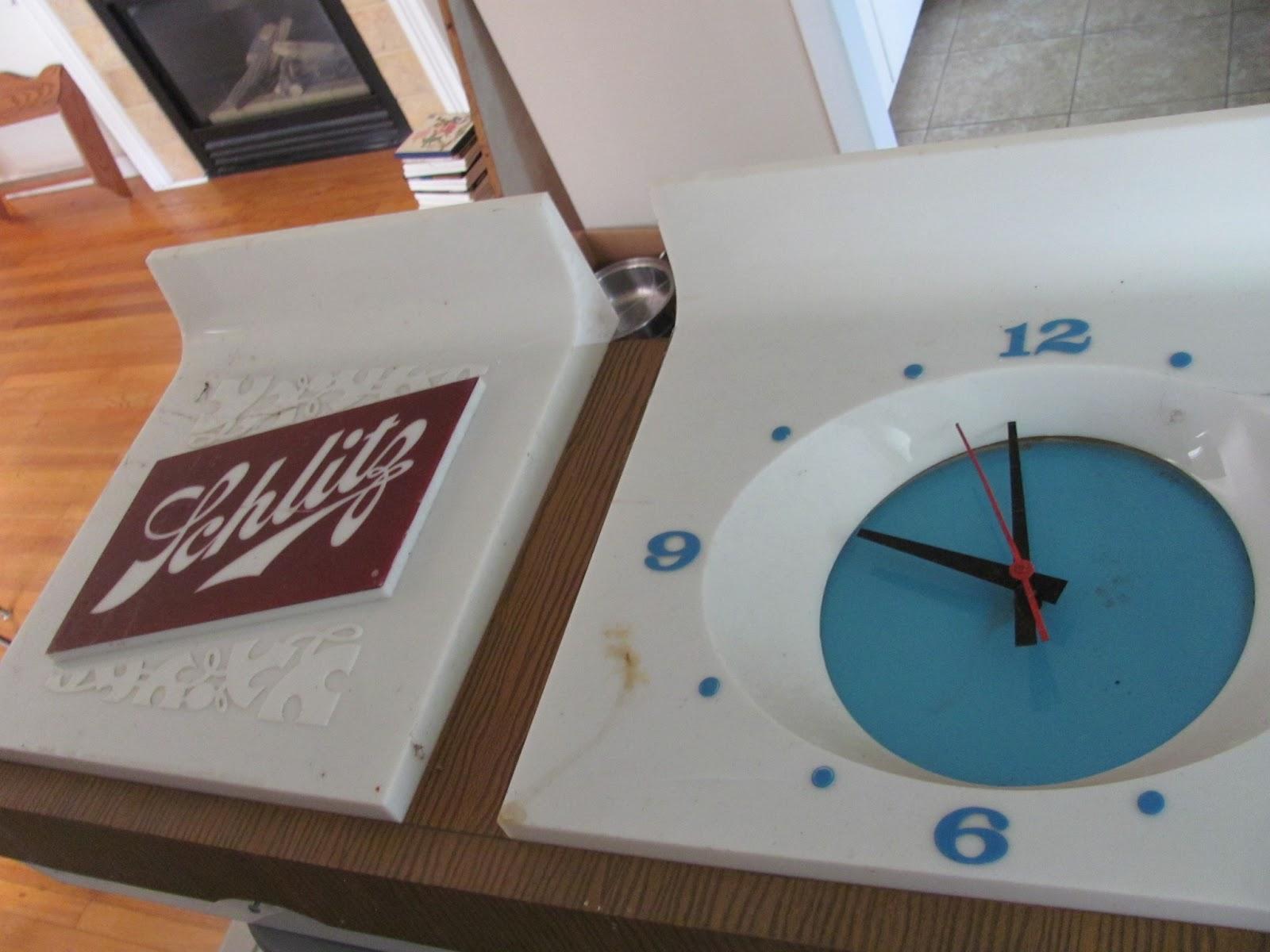 A gift from my neighbor, a Schlitz bar light and clock