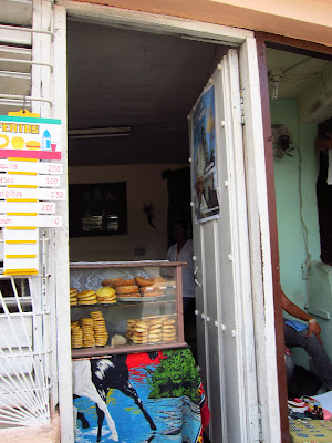 Santiago de Cuba small food shop in doorway