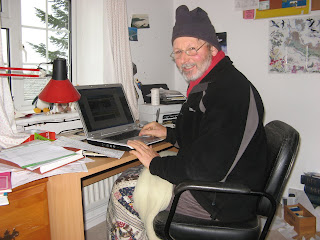 The author, thoroughly well wrapped and insulated, at his desk, preparing to write this blog