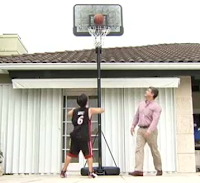 Jack Meyer shooting hoops with his father